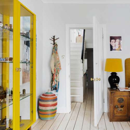The African woven laundry hamper and the branch used as a wall hook perfect the eclectic look Homewings designer Cornelia was going for. These hampers come in a wide range of colour combinates, sizes and shapes.